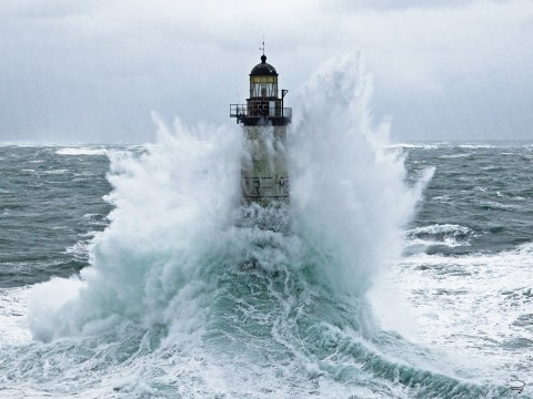 Photo Ar Men lighthouse under the waves, Brittany par Philip Plisson