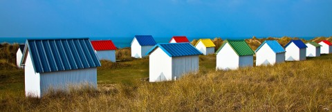 Photo Beach huts in Gouville-sur-Mer, Normandy par Philip Plisson