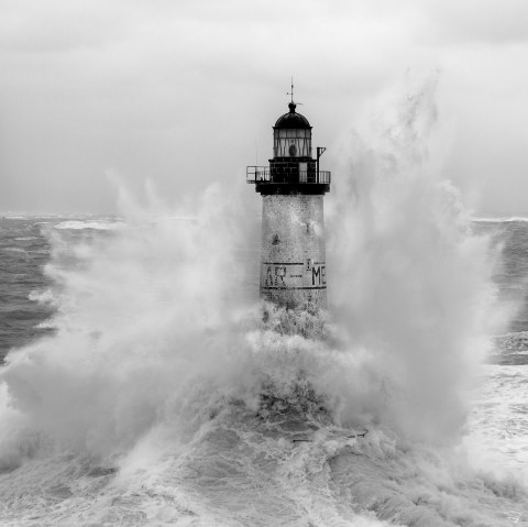 Photo Ar Men lighthouse in the middle of a storm, Brittany par Philip Plisson